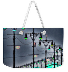 Weekender Tote Bag featuring the photograph Boardwalk Lights by Chris Lord