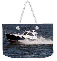 Weekender Tote Bag featuring the photograph Boating On The Bay by Karen Harrison