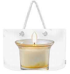 Weekender Tote Bag featuring the photograph Burning Candle by Atiketta Sangasaeng