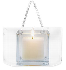 Weekender Tote Bag featuring the photograph Burning Candle Front View  by Atiketta Sangasaeng