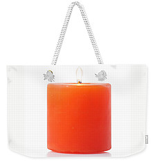 Weekender Tote Bag featuring the photograph Burning Red Candle by Atiketta Sangasaeng