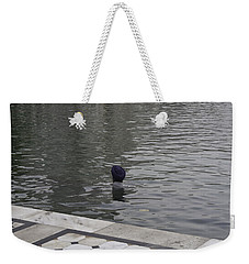 Weekender Tote Bag featuring the photograph Cleaning The Sarovar In The Golden Temple by Ashish Agarwal