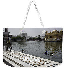 Weekender Tote Bag featuring the photograph Clearing The Sarovar Inside The Golden Temple Resorvoir by Ashish Agarwal