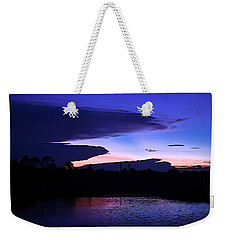 Weekender Tote Bag featuring the photograph Clouded Sunset Over The Tomoka by DigiArt Diaries by Vicky B Fuller