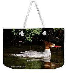 Weekender Tote Bag featuring the photograph Common Merganser by Steven Clipperton