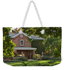 Weekender Tote Bag featuring the photograph Cowles House by Joseph Yarbrough
