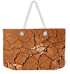 Weekender Tote Bag featuring the photograph Cracked Red Soil  by Les Palenik
