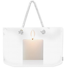 Weekender Tote Bag featuring the photograph Cubic Burning Candle  by Atiketta Sangasaeng