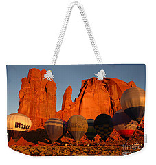 Weekender Tote Bag featuring the photograph Dawn Flight In Monument Valley by Vivian Christopher