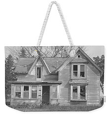 Weekender Tote Bag featuring the photograph Defiance B/w by Bonfire Photography