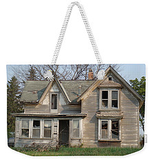 Weekender Tote Bag featuring the photograph Defiance by Bonfire Photography
