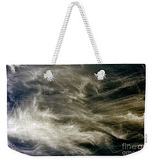 Weekender Tote Bag featuring the photograph Dirty Clouds by Clayton Bruster