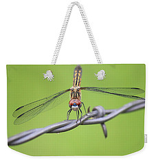 Weekender Tote Bag featuring the photograph Dragonfly On Barbed Wire by Penny Meyers