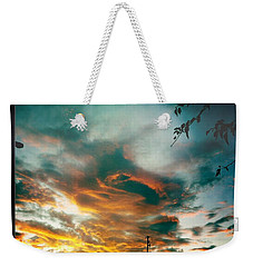 Weekender Tote Bag featuring the photograph Drama In The Sky by Nina Prommer