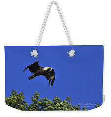 Weekender Tote Bag featuring the photograph Eagle Over The Tree Top by Randall Branham
