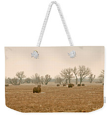 Weekender Tote Bag featuring the photograph Earlying Morning Hay Bails by James Steele