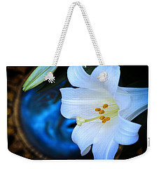 Weekender Tote Bag featuring the photograph Eclipse With A Lily by Steven Sparks