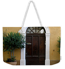 Weekender Tote Bag featuring the photograph Enchanting Door by Lainie Wrightson