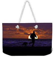 Weekender Tote Bag featuring the photograph Evening Run On The Beach by Clayton Bruster