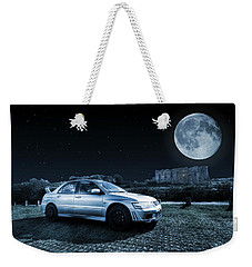 Weekender Tote Bag featuring the photograph Evo 7 At Night by Steve Purnell