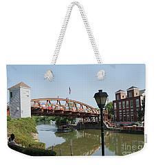Weekender Tote Bag featuring the photograph Fairport Lift Bridge by William Norton