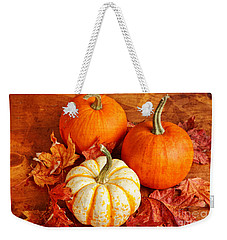 Weekender Tote Bag featuring the photograph Fall Pumpkins And Decorative Squash by Verena Matthew