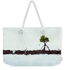 Weekender Tote Bag featuring the photograph Falling Mangrove Leaf by Dan Friend