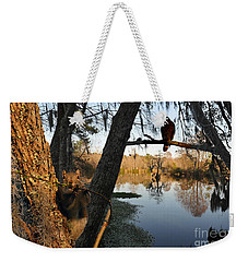 Weekender Tote Bag featuring the photograph Feel Like Being Watched by Dan Friend