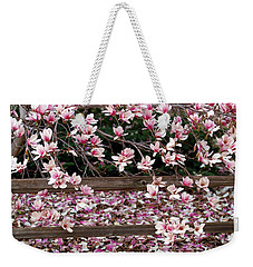 Weekender Tote Bag featuring the photograph Fence Of Flowers by Elizabeth Winter