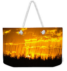 Weekender Tote Bag featuring the photograph Firey Sunset by Shannon Harrington