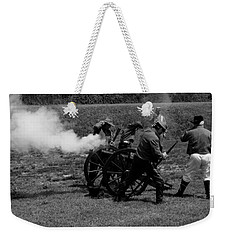 Weekender Tote Bag featuring the photograph Firing The Canon by Karen Harrison