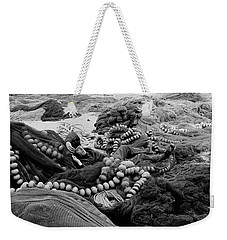Weekender Tote Bag featuring the photograph Fisherman Sleeping On A Huge Array Of Nets by Tom Wurl