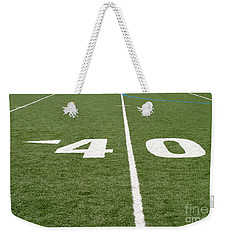 Weekender Tote Bag featuring the photograph Football Field Forty by Henrik Lehnerer