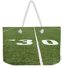 Weekender Tote Bag featuring the photograph Football Field Thirty by Henrik Lehnerer