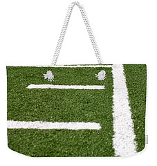 Weekender Tote Bag featuring the photograph Football Lines by Henrik Lehnerer