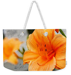 Weekender Tote Bag featuring the photograph Garden Lily by Davandra Cribbie
