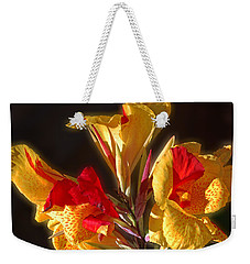 Weekender Tote Bag featuring the photograph Glowing Iris by DigiArt Diaries by Vicky B Fuller