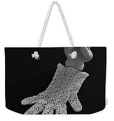 Weekender Tote Bag featuring the sculpture Hand And Glove by Barbara St Jean