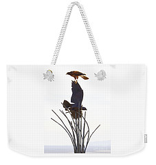Weekender Tote Bag featuring the photograph Hawk On Statue by Rebecca Margraf