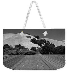 Weekender Tote Bag featuring the photograph Hillside Farmland by Kathleen Grace