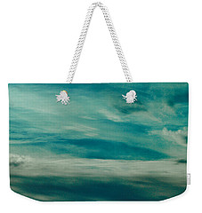 Weekender Tote Bag featuring the photograph Icelandic Sky by Michael Canning