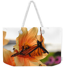 Weekender Tote Bag featuring the photograph In Flight... by Michael Frank Jr