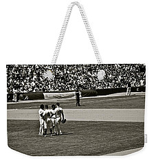 Weekender Tote Bag featuring the photograph Infield Meeting by Eric Tressler