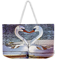 Weekender Tote Bag featuring the photograph Kissing Swans by Alice Gipson