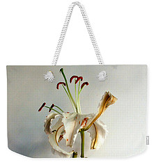 Weekender Tote Bag featuring the photograph Last Moments by Pravine Chester