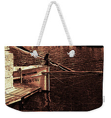 Weekender Tote Bag featuring the photograph Lil Kiss by Pedro Cardona