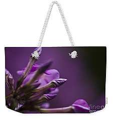 Weekender Tote Bag featuring the photograph Lilac Spirals. by Clare Bambers