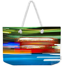 Weekender Tote Bag featuring the photograph London Bus Motion by Luciano Mortula