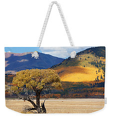Weekender Tote Bag featuring the photograph Lone Tree by Jim Garrison