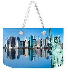 Weekender Tote Bag featuring the photograph Manhattan Liberty by Luciano Mortula